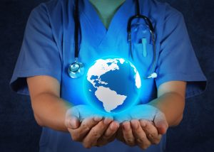Medical Doctor holding a world globe in his hands as medical network concept