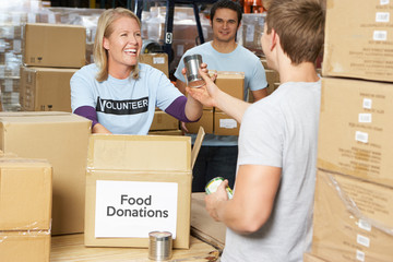 Volunteers Collecting Food Donations In Warehouse - feed my starving children