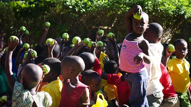 feed the children - children holding green apples