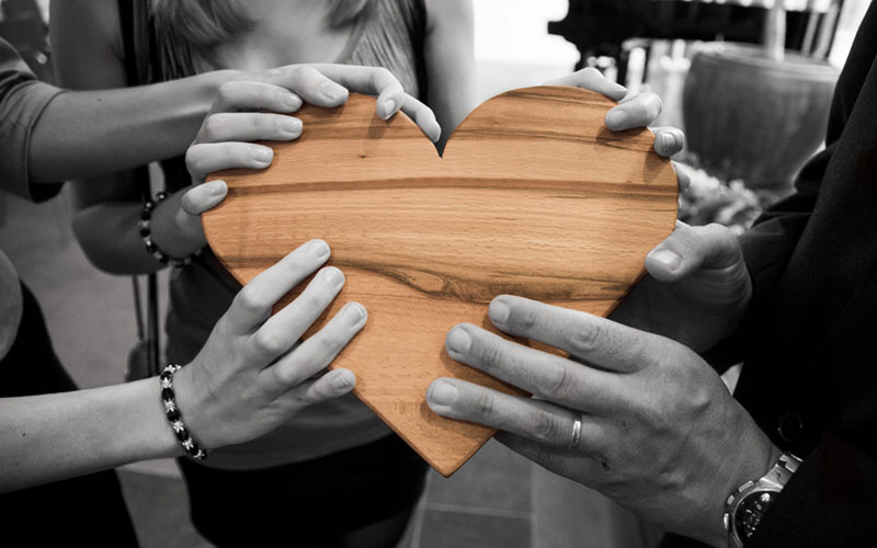 People holding heart shape