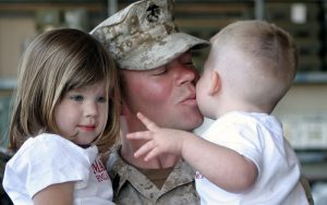 military kissing his son