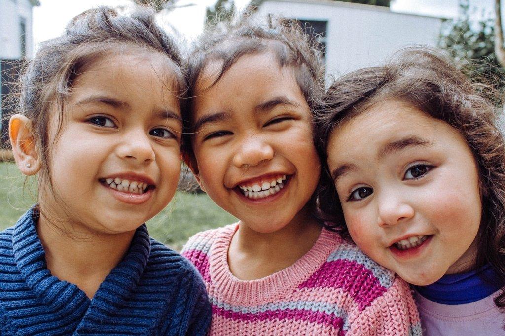 Three girls smiling