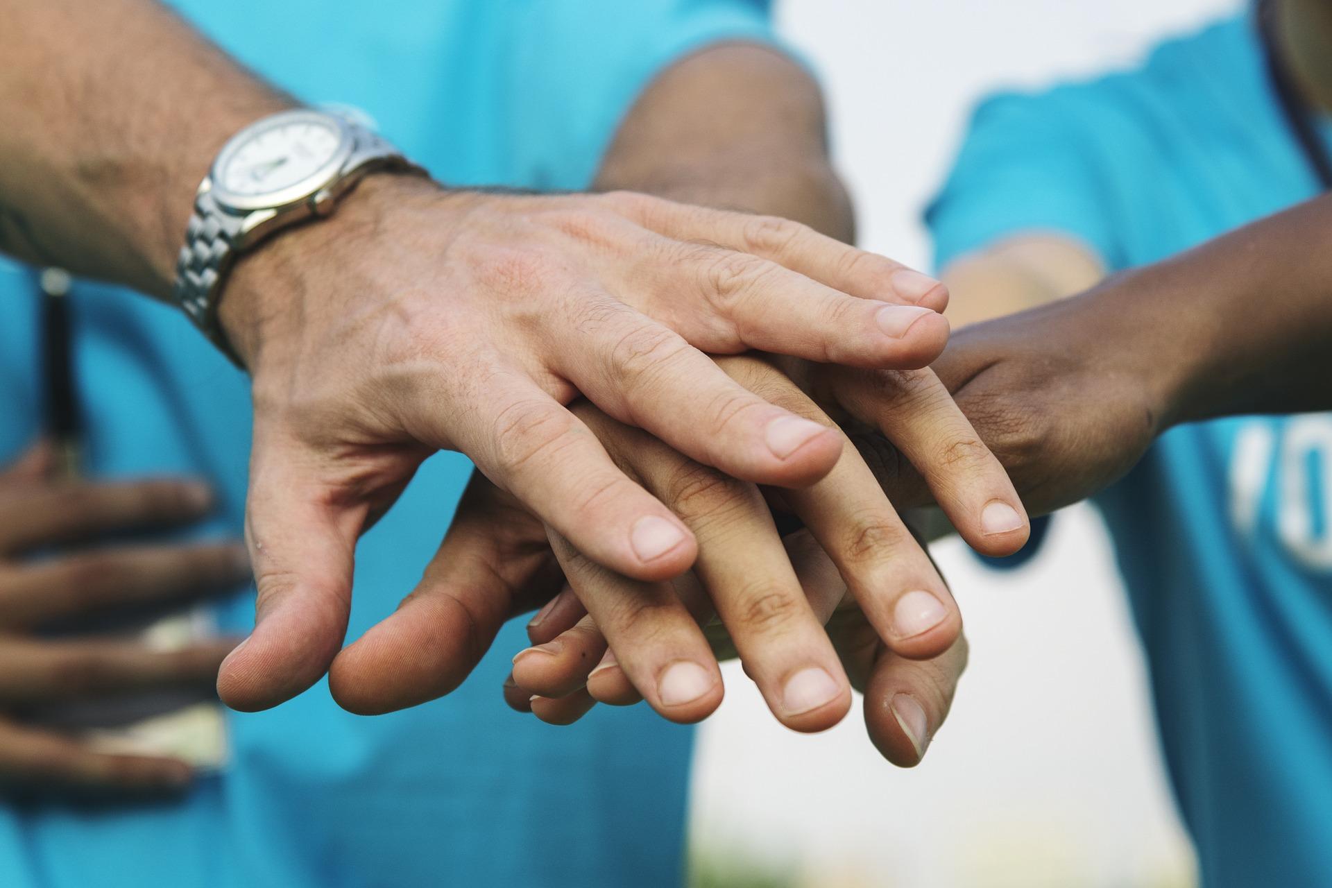 Hand wearing rolex
